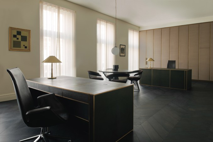 London office by Hollie Bowden with matching facing desks and gold lamps