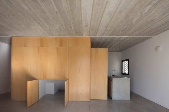 Interior of brick house with plywood centre