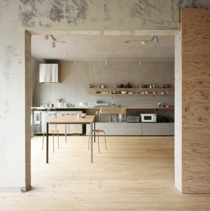 The kitchen is lined against a rendered wall