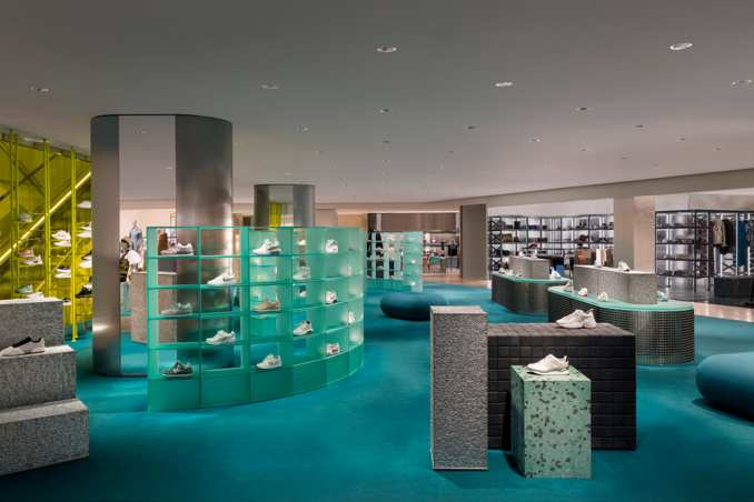 Overview of La Rinascente womenswear department with blue carpet and grey displays