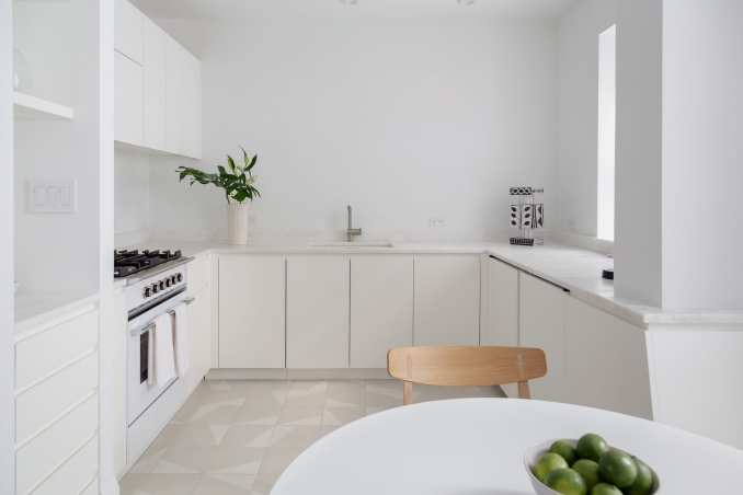 White Brooklyn apartment kitchen renovation with tiles