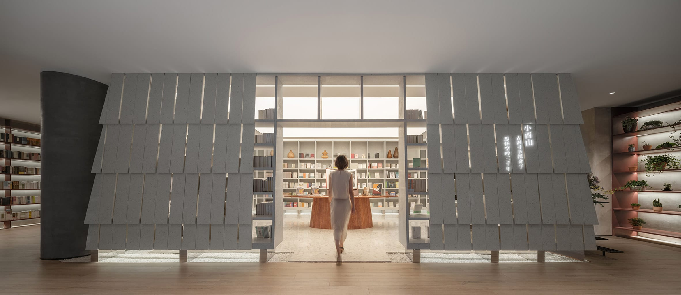 Wutopia Lab installed a bookshelf formed from white panels