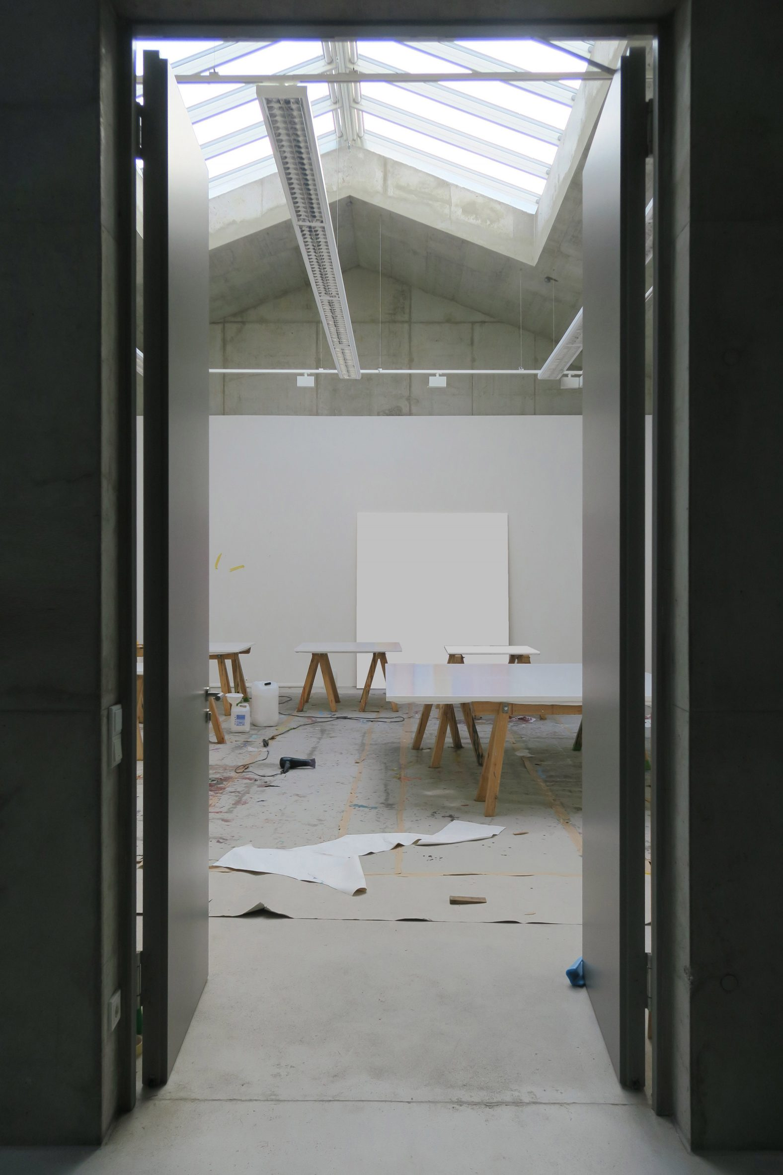 Artist's studio with trestle tables in O12 residence