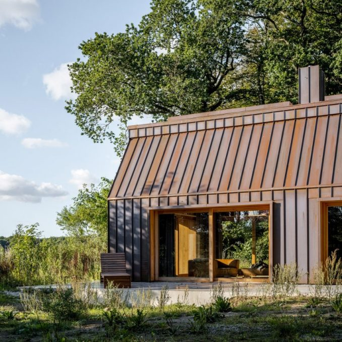 Copper cladding and wood-framed doors of The Author's House by Sleth