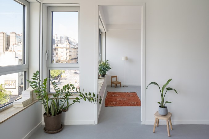 An apartment with grey flooring