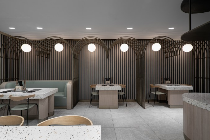 Hotpot restaurant by SHH with metal arches over seating areas