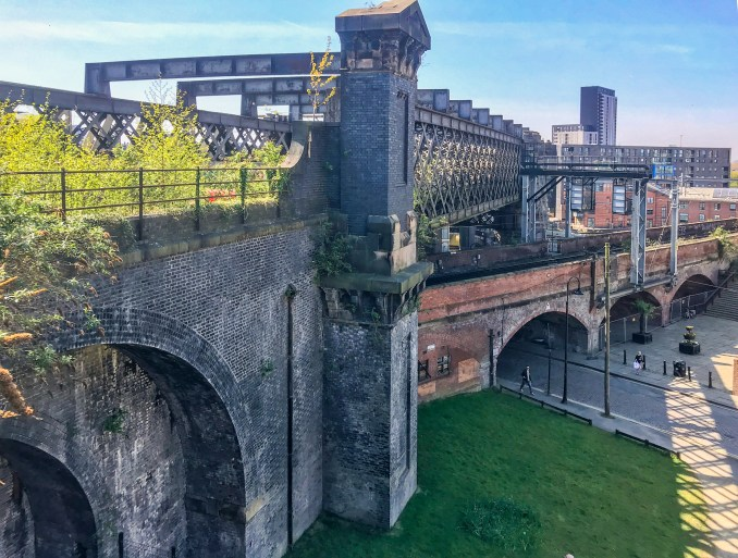 The castlefield viaduct is located above a canal