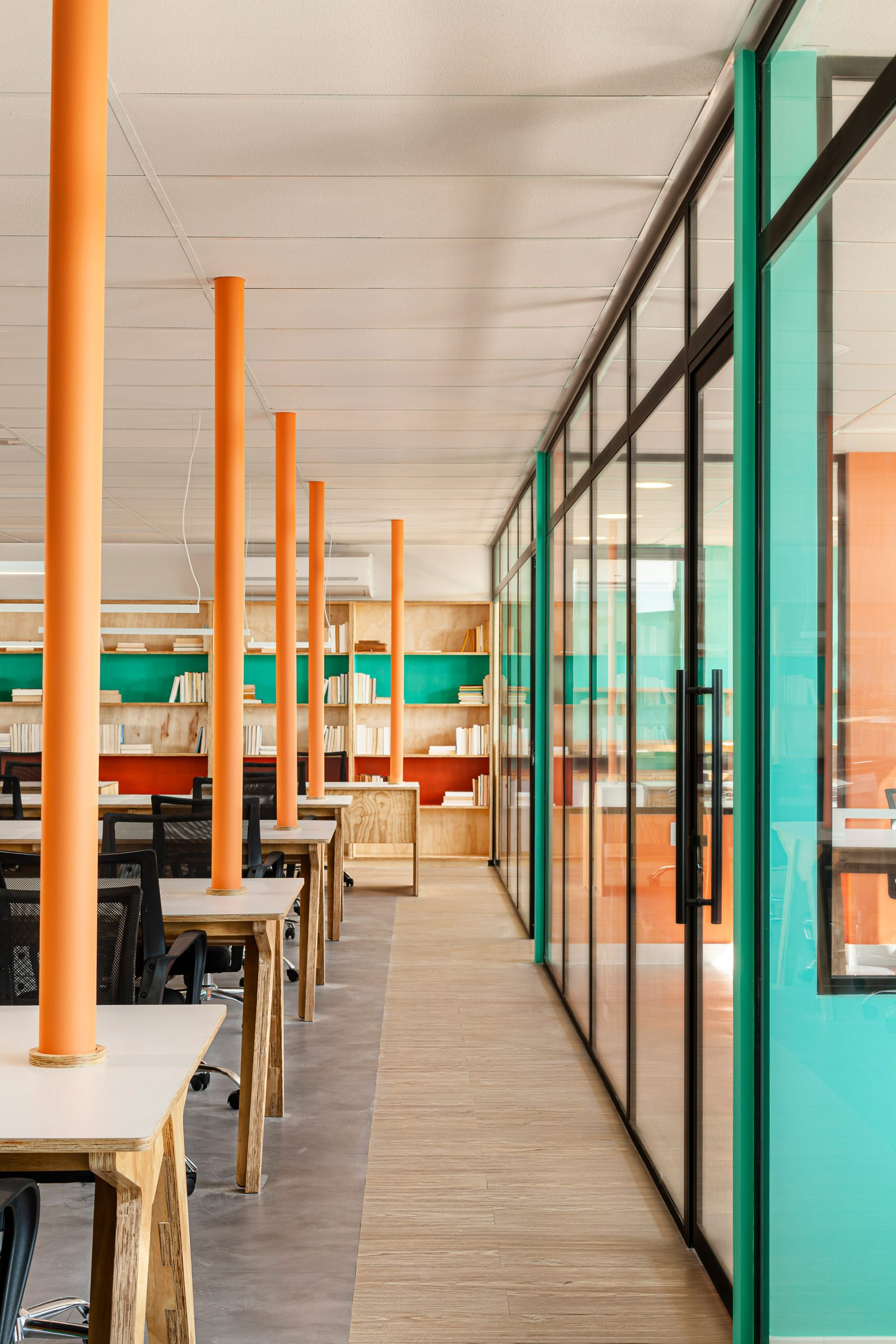 Glazing separates private offices from the main areas