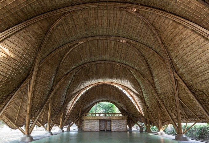 There is a brick structure within the bamboo canopy