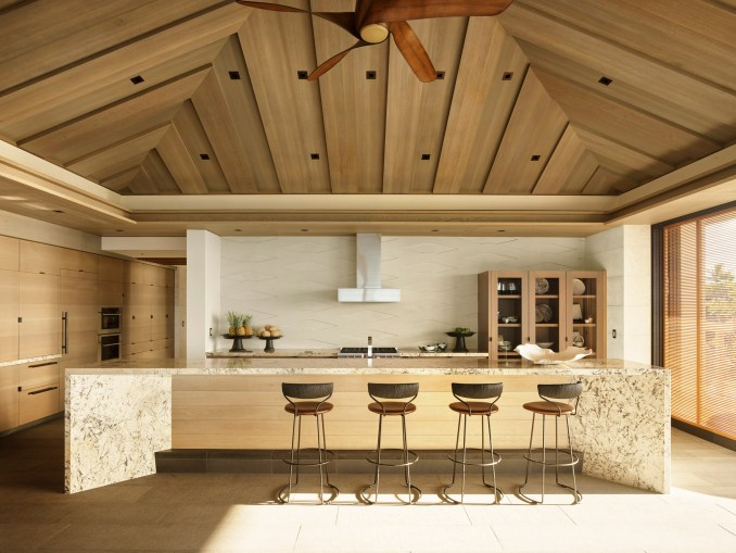 A muted palette of wood is seen in the kitchen