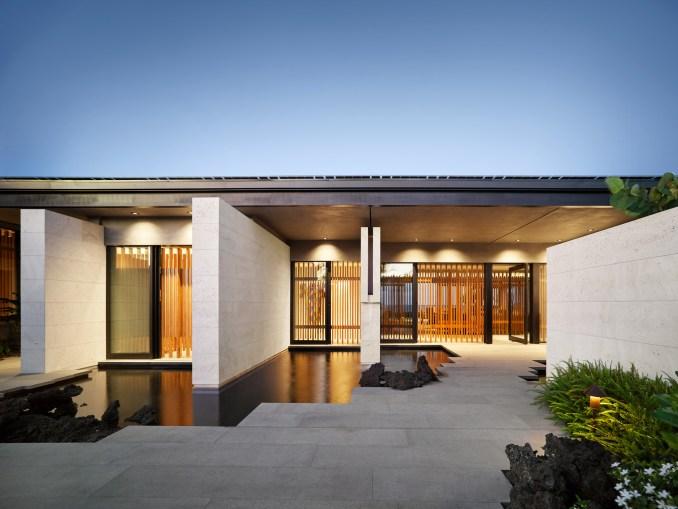 The villa has sliding architectural screens