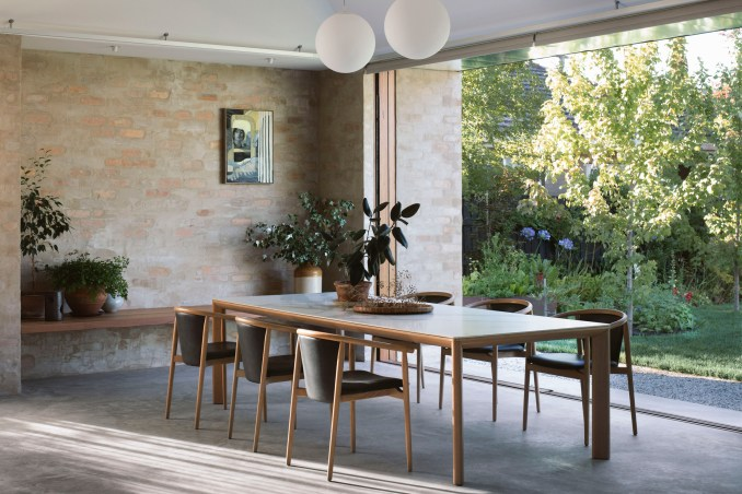 A dining room with brick walls