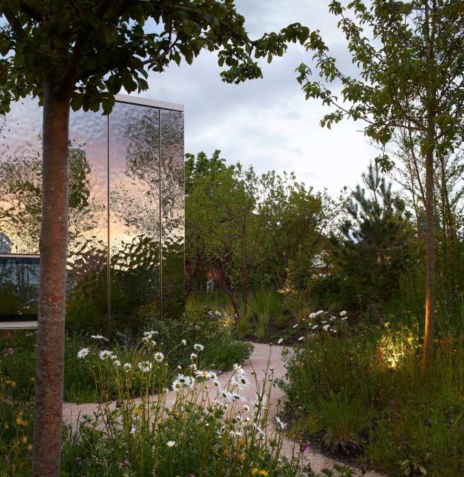 A mirrored pavilion surrounded by gardens