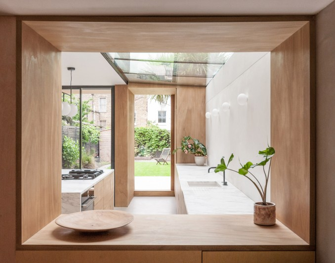 A view into a white-walled kitchen in London