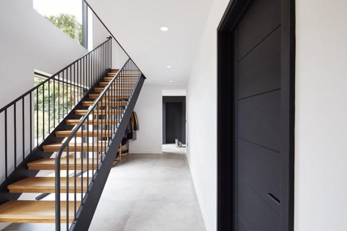 A wooden open-tread staircase