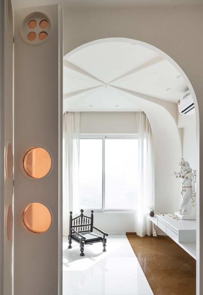 Residential temple interior by The Act of Quad with white marble and stone floors and arched ceiling