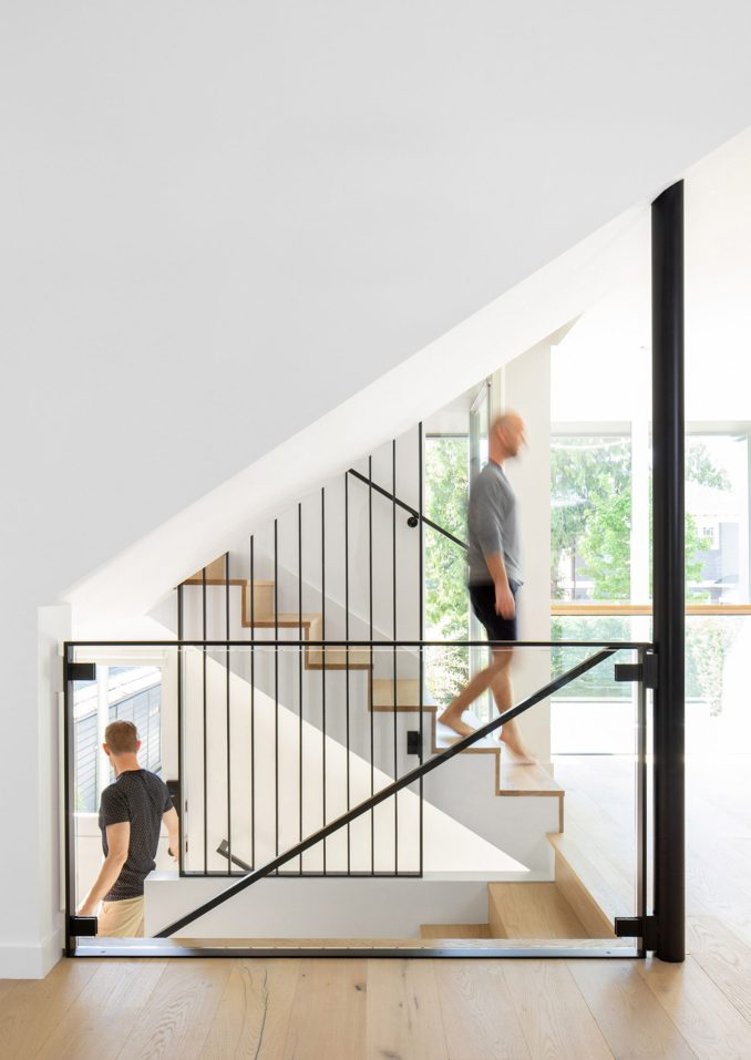 Boathouse Bungalow has a steel and glass staircase