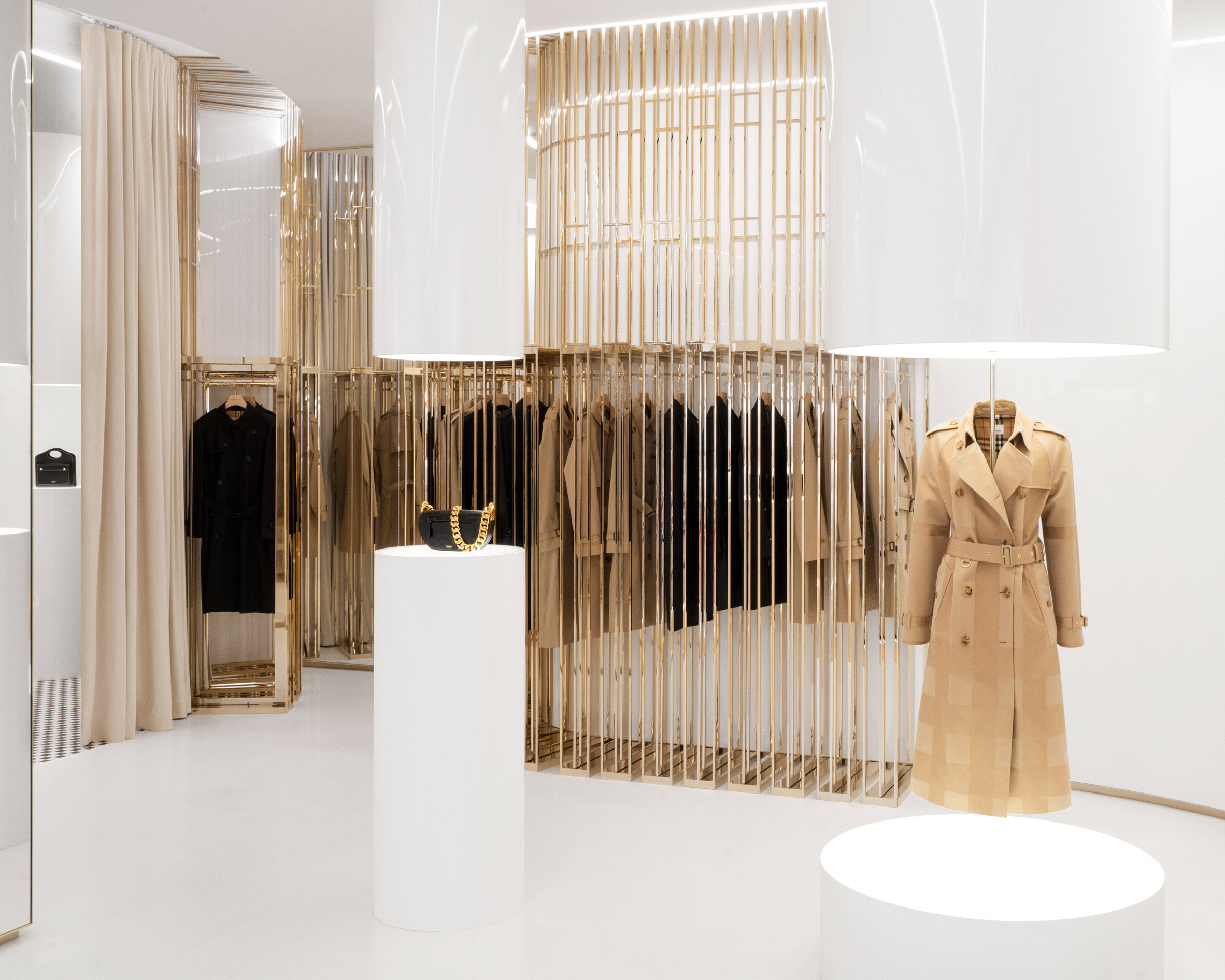 Burberry trench coat displayed in London flagship using champagne-coloured steel rails
