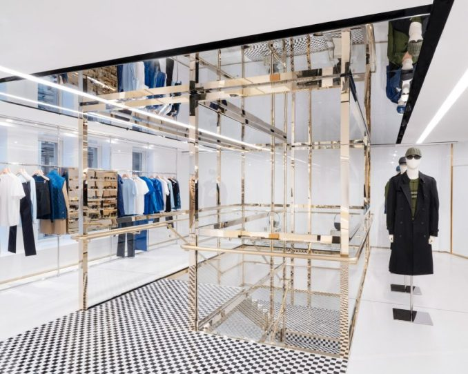 Champagne-coloured steel staircase with checked tiles in Burberry London flagship