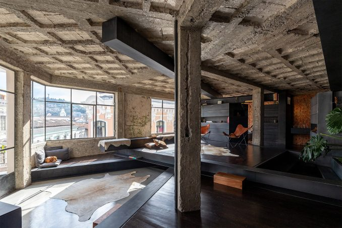 concrete living room by Jarrín