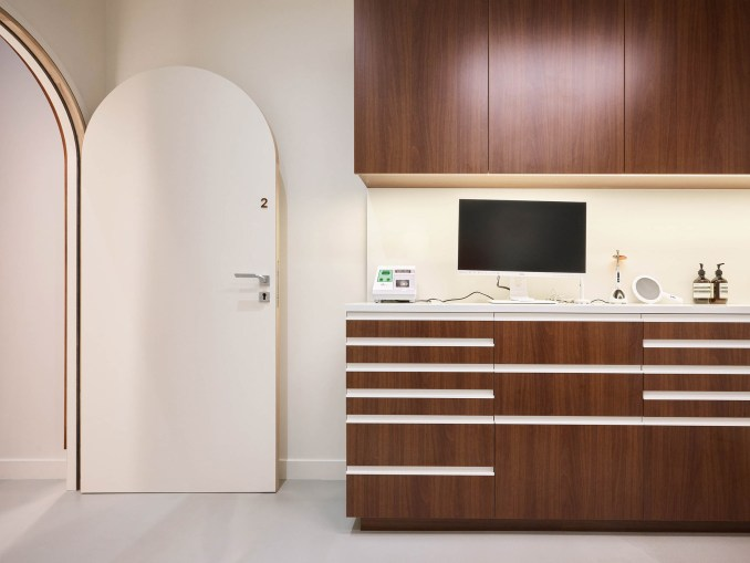 A brown counter in a dentist's next to a white door