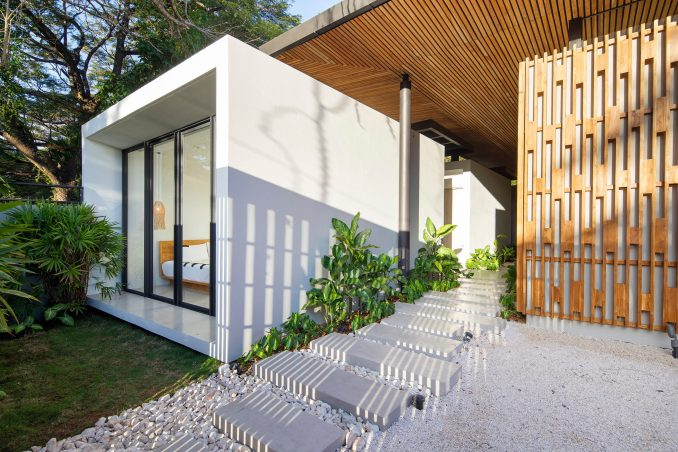 Concrete bedroom pod with walkway in house by Studio Saxe