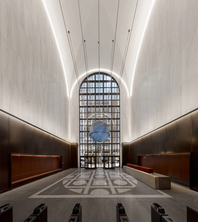 The lobby of 550 Madison features terrazzo marble and bronze