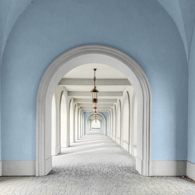 A white archway with blue skies Dulux paint