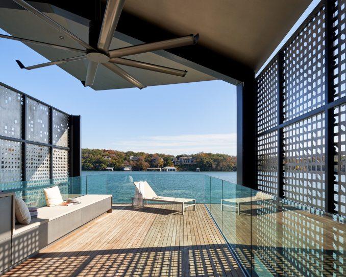 Glass balustrades wrap the upper deck