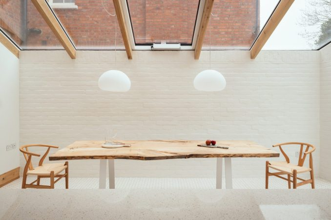 A dining room with a whitewashed brick