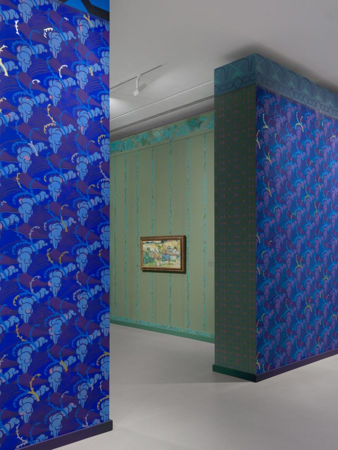 Blue and green wallpaper with geometric patterns