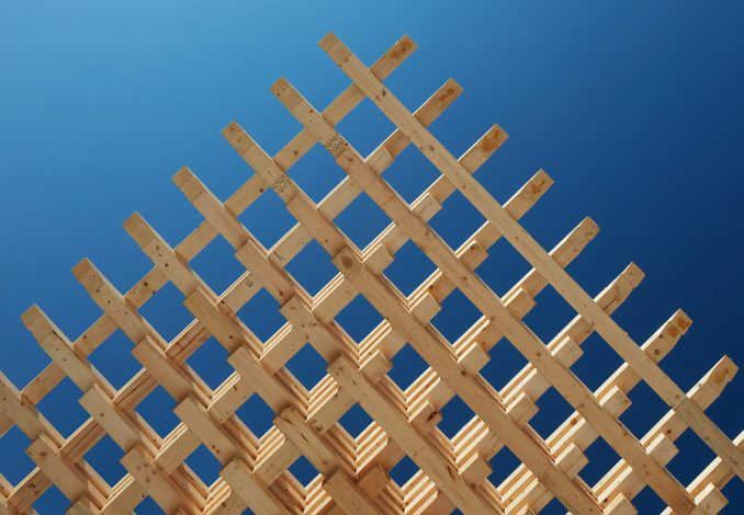 Interlocking wood pieces make up a structural timber framing system