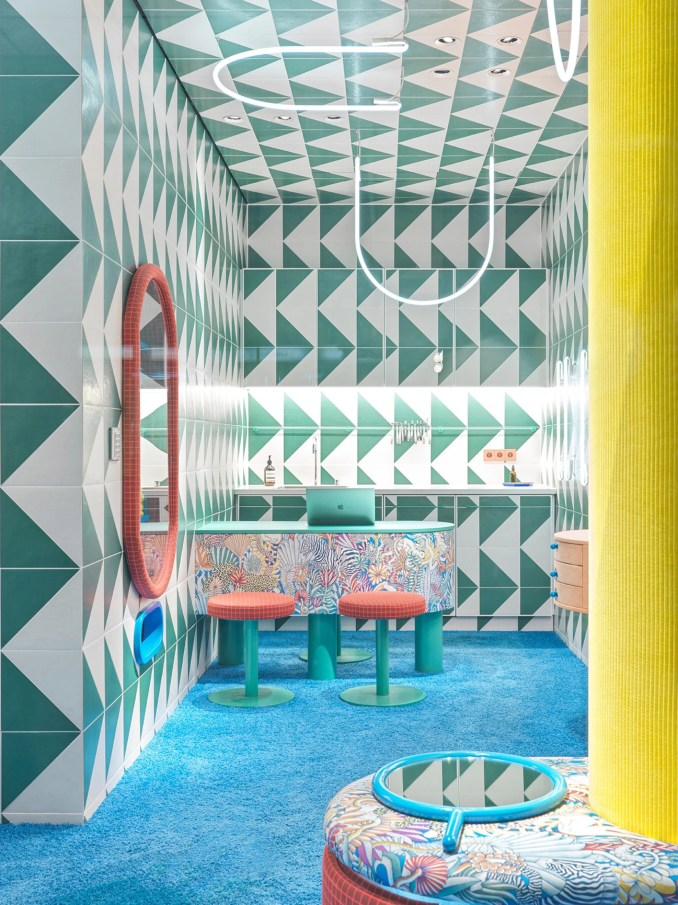 Contrasting coloured furniture was placed throughout the Leidmann eyewear store by Stephanie Thatenhorst