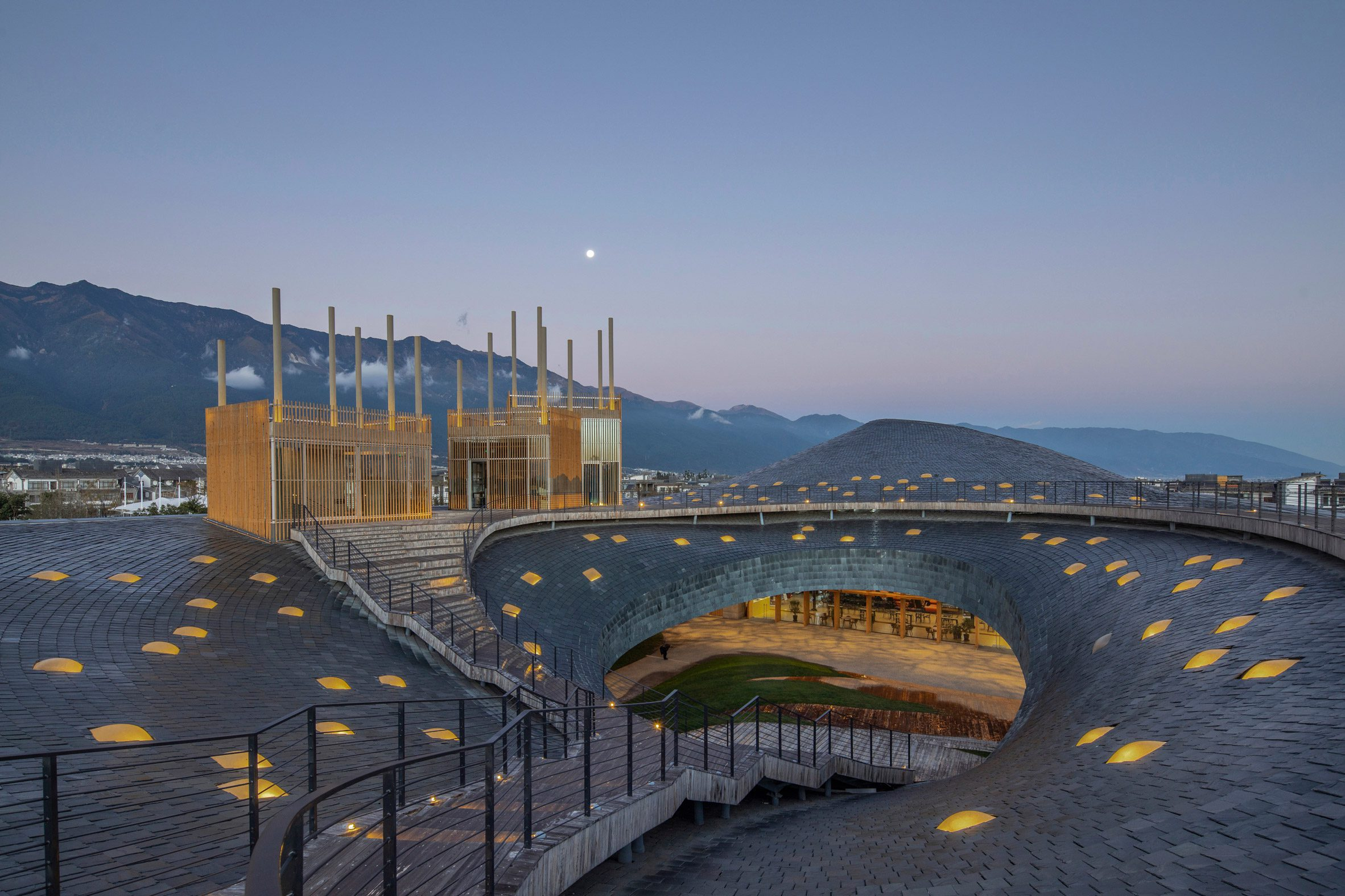 Yang Liping Performing Arts Center has an organic form informed by the mountains