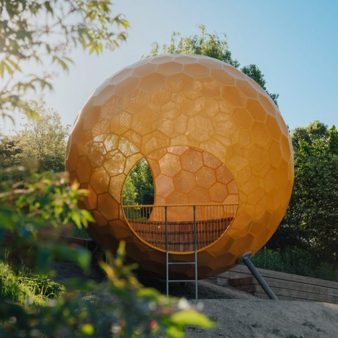 A yellow sphere in a playground in Stockholm