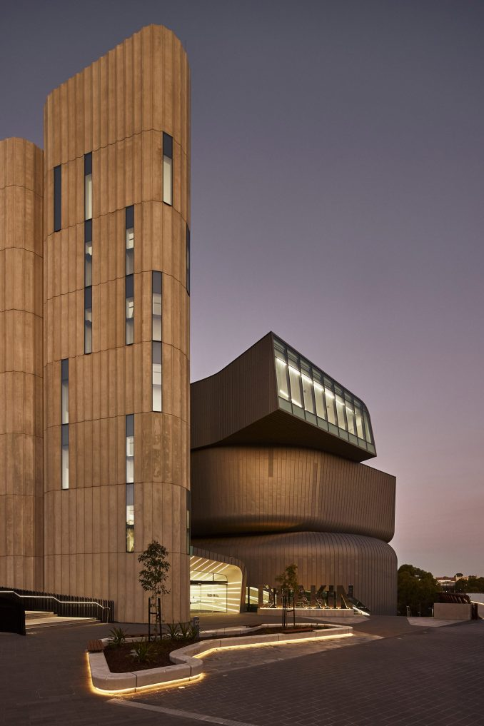 The Deakin Law School pictured at dusk with light reflecting off the exterior