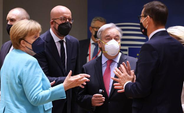 Angela Merkel, Michel and Guterres, upon arrival at the European summit.