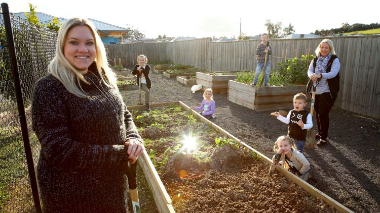 Katandra Rise residents Georgia Ramsey and Christine Murray with their children, Lyla ,Isla , Rhys, Arley and Jensen, love eating the food they produce in the community garden.