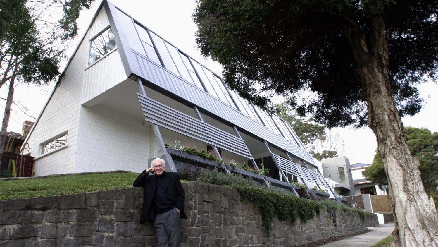 McIntyre pictured in 2003 in front of his first project, 2 Tauras Street, Balwyn North.