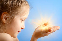 Child holding a sun Royalty Free Stock Images
