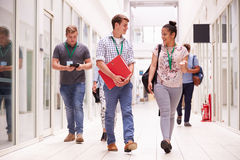 Group Of College Students Walking Along Corridor Royalty Free Stock Photos