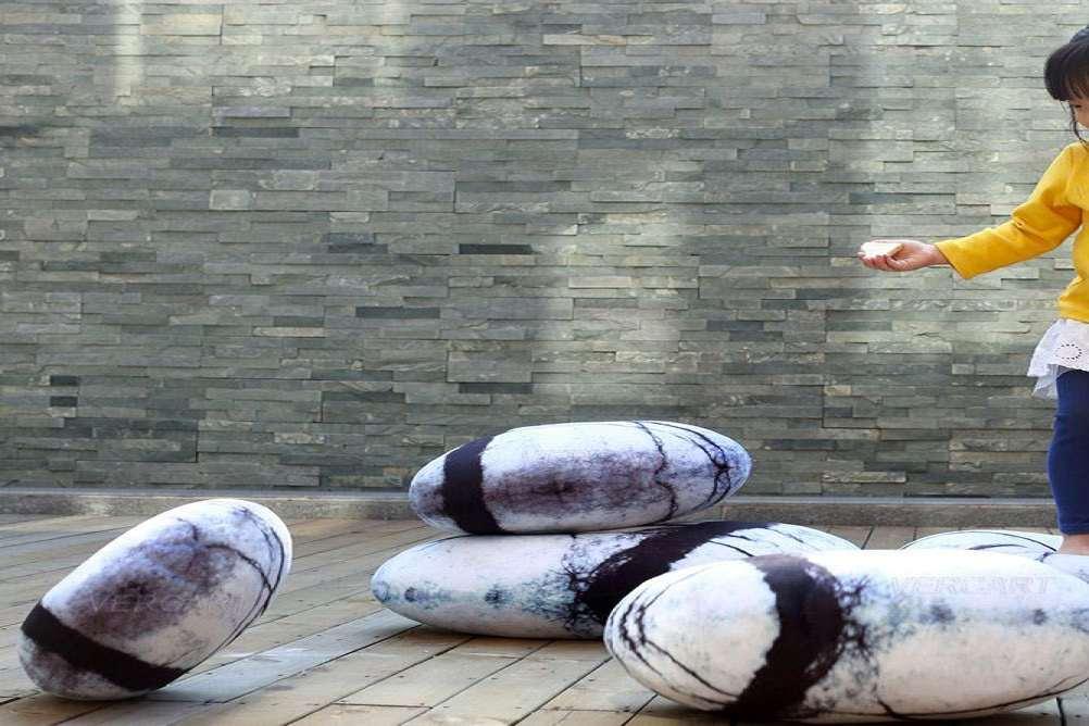 big joe roma floor chair vintage waiting room chairs zen stone pillows | dudeiwantthat.com