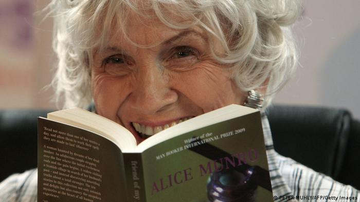Canadian author Alice Munro holds one of her books Photo: PETER MUHLY/AFP/Getty Images