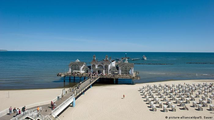 Pier at the Baltic Sea resort of Sellin with a white sandy beach and sea on the island of Rügen, Germany