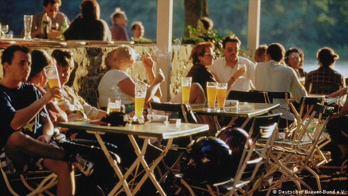 Germany, people sitting in a beer garden