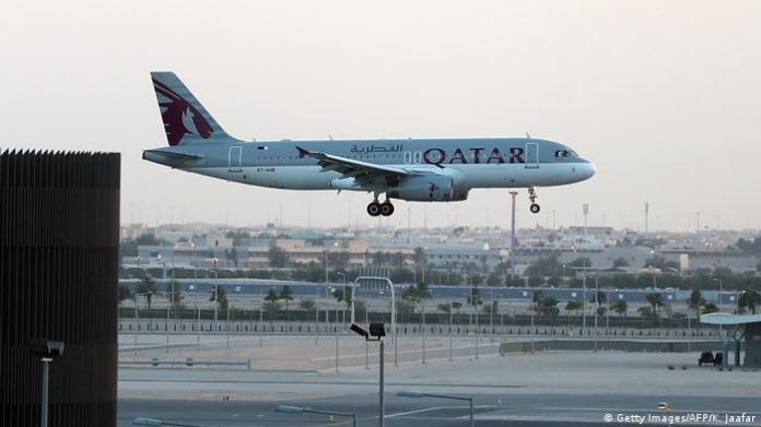 A symbolic picture of a Qatar Airways plane landing at Doha airport.