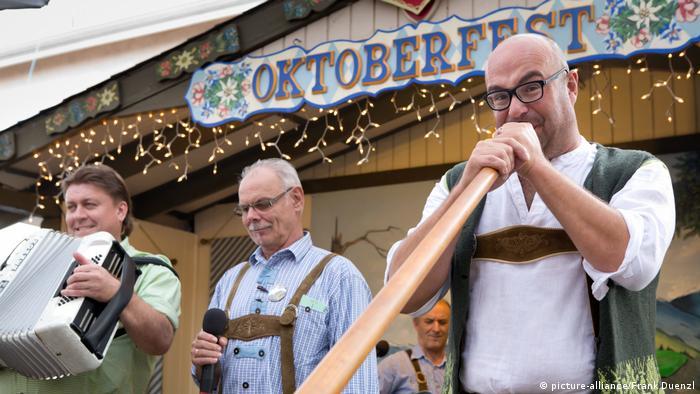 Men play musical instruments at the Oktoberfest celebrations in El Cajon in California.