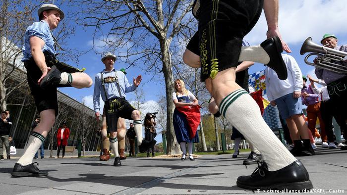 People perform traditional Bavarian Oktoberfest dance in a street in Melbourne, Australia.