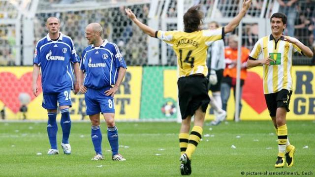 Christian Pander, Fabian Ernst look on as Ebi Smolarek and Nuri Sahin celebrate