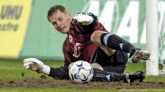Schalke keeper Frank Rost makes a save